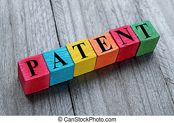 word patent on colorful wooden cubes