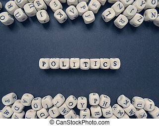 Word Politics of small white cubes on a dark background