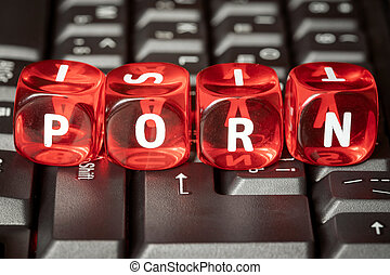 Word PORN on red toy cubes placed on computer keyboard
