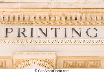 "Word ""Printing"" on the Side of a Building Facade - The word..."