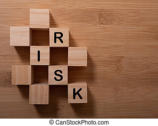 Word risk writing with wooden blocks