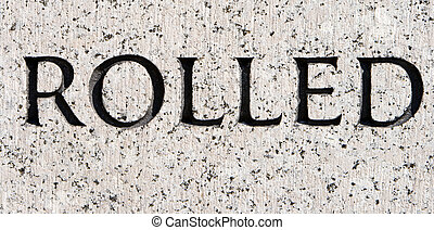 """Word """"Rolled"""" Carved in Gray Granite Stone"""