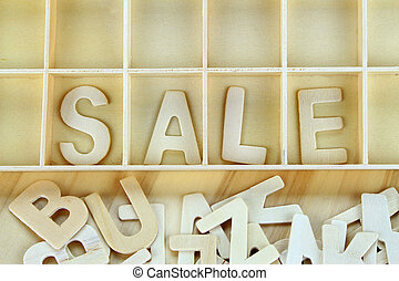 Word sale made with wooden letters alphabet