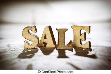 Word sale made with wooden letters