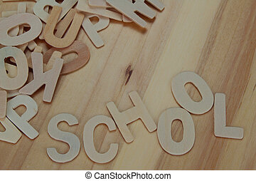 Word school made with wooden letters alphabet