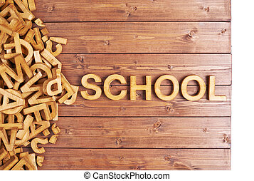Word school made with wooden letters