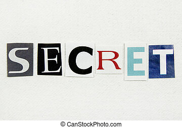 word secret cut from newspaper on white paper
