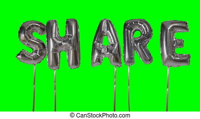 Word share from helium silver balloon letters floating on...