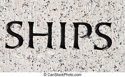 """Word """"Ships"""" Carved in Gray Granite Stone Boats"""