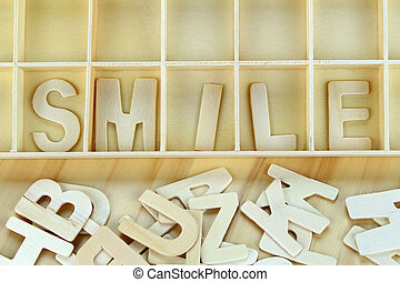 Word smile made with wooden letters alphabet