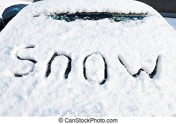 Word snow on windshield of car