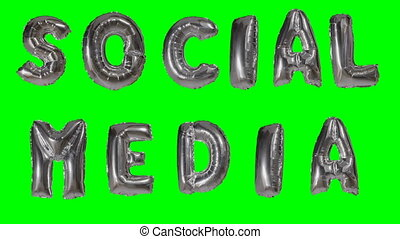 Word social media from helium gold balloon letters floating...