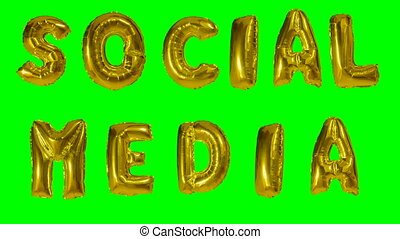 Word social media from helium golden balloon letters...
