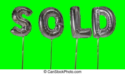 Word sold from helium silver balloon letters floating on...