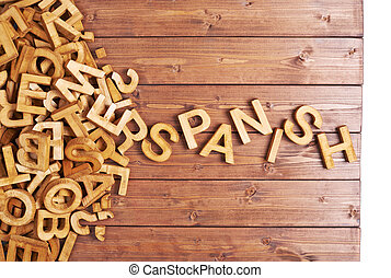 Word spanish made with wooden letters