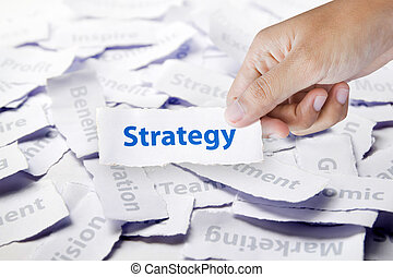 Word Strategy in hand, business concept