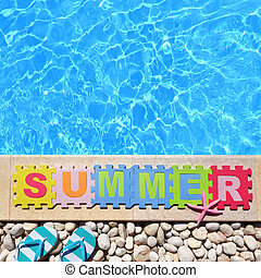 "Word ""Summer"" by poolside made with jigsaw puzzle pieces"