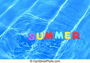 Photo of the word SUMMER made from foam letters floating in water on the surface of a swimming pool.