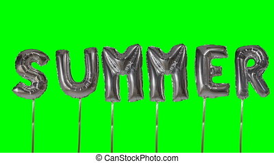 Word summer from helium silver balloon letters floating on...