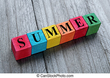 word summer on colorful wooden cubes