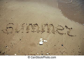 Word Summer written on sandy beach.