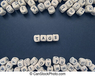 Word Tags of small white cubes on a dark background