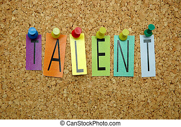 """Word """" Talent """" placed from colourful small letters on the cork board"""