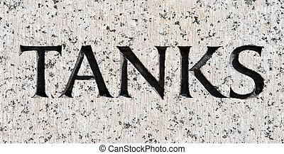 """Word """"Tanks"""" Carved in Gray Granite Stone"""