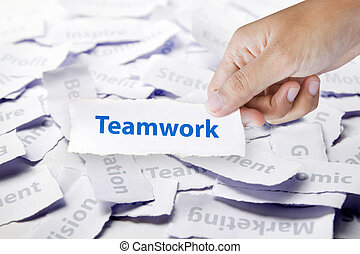 Word Teamwork in hand, business concept