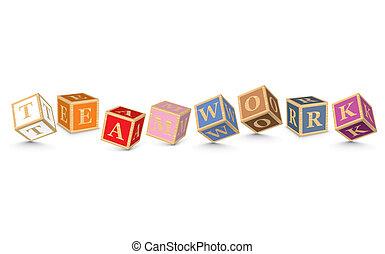 TEAMWORK written with alphabet blocks - vector illustration