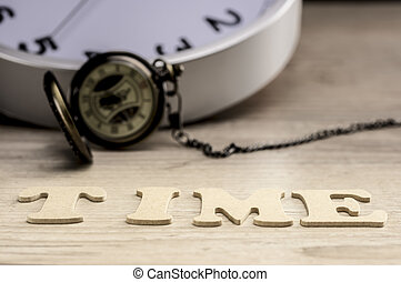 Word time concept with wooden letters