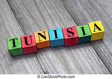 word tunisia on colorful wooden cubes