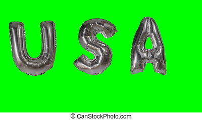 Word USA from helium silver balloon letters floating on...