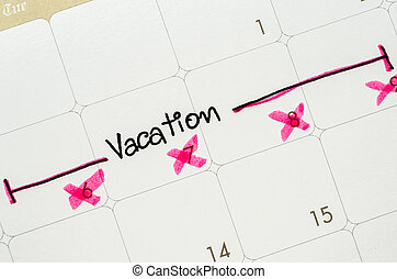 Word vacation is written on a calendar.