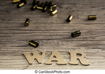 Word war concept with wooden letters