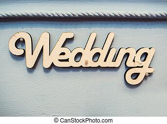 "Word ""wedding"" on wooden background"