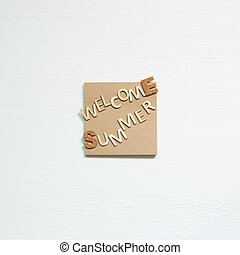 Word 'Welcome summer' on memo pad on white background. Summer vacation concept. top view