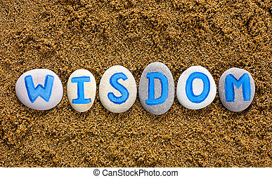 Wisdom - Word Wisdom spell out from stones with letters on...