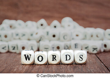 word with dice on white background
