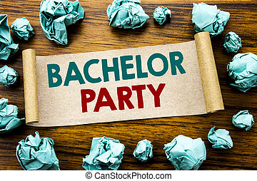 Word, writing Bachelor Party. Business concept for Stag Fun Celebrate Written on sticky note paper, wooden background with folded yellow paper meaning thinking