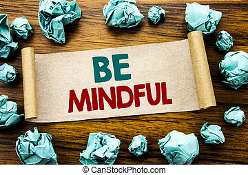 Word, writing Be Mindful. Business concept for Mindfulness Healthy Spirit Written on sticky note paper, wooden background with folded yellow paper meaning thinking