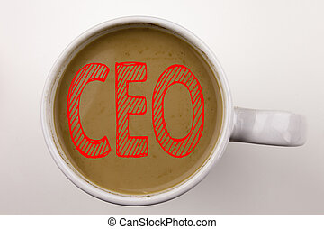 Word, writing CEO text in coffee in cup. Business concept for Operating Leader Business Executive President on white background with copy space. Black text with red word.