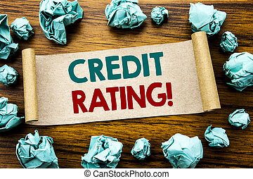 Word, writing Credit Rating. Business concept for Finance Score History Written on sticky note paper, wooden background with folded yellow paper meaning thinking