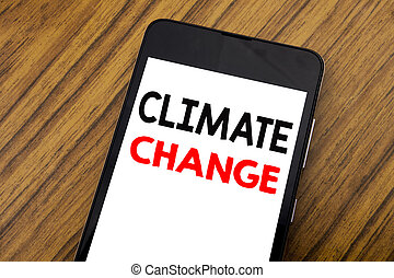 Word, writing handwriting Climate Change. Business concept for Global Planet Warming Written on mobile phone cellphone, wooden background with copy space.