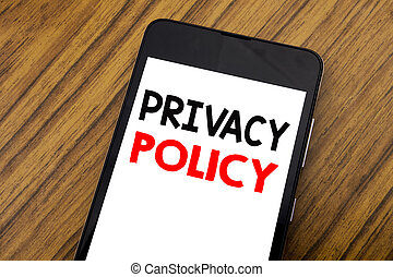 Word, writing handwriting Privacy Policy. Business concept for Safety Data Rules Written on mobile phone cellphone, wooden background with copy space.