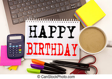 Word writing Happy Birthday in the office with surroundings such as laptop, marker, pen, stationery, coffee. Business concept for Anniversary Celebration Workshop white background with copy space