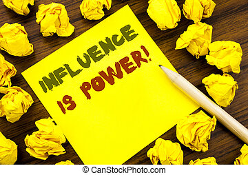 Word, writing Influence Is Power. Business concept for Persuasion Strategy Written on sticky note paper, wooden background with folded yellow paper meaning thinking