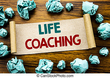 Word, writing Life Coaching. Business concept for Personal Coach Help Written on sticky note paper, wooden background with folded yellow paper meaning thinking