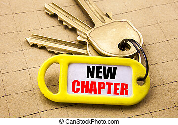 Word, writing New Chapter. Business concept for Starting New Future Life Written on key holder, textured background close up.