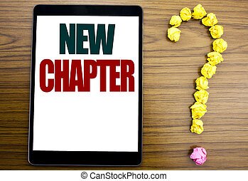 Word, writing New Chapter. Business concept for Starting New Future Life Written on tablet, wooden background with question mark on the end.